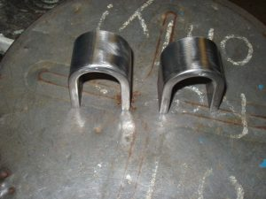 Successful FCAW Welding Certification coupon bend test of the face and root coupons.