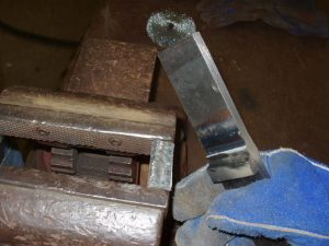 Weld test backing bar removal