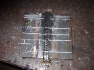 3G FCAW Welding Certification Test Marked for Face, Root and Alternative Bend Test Coupons.