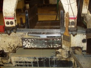 Cutting a 3G Weld Test with a Horizontal Band Saw