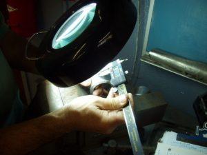 Certified Welding Inspector Examining Weld Test Coupon