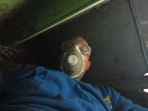 Confined space with bad air quality wearing a dirty respirator.
