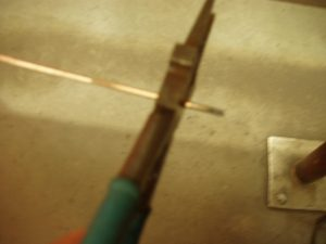 Contaminated TIG Wire Being Cut