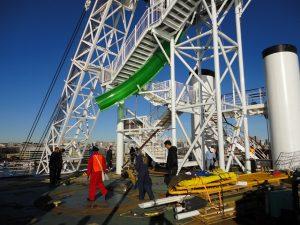 Carnival Spirit water slide being lowered on deck.