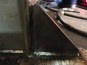 FCAW weld on gusset using a E71-T electrode in the horizontal position or 1f position.