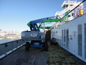 Genie S-65 on top deck of cruise ship.