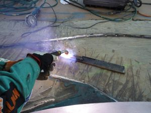 Setting up the Fluxed Cored Arc Welder and dialing it in for our material thickness.