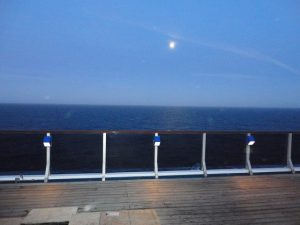 Moon over top deck of Carnival Spirit.