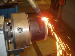 Pipe Coupon in Watts Pipe Beveler Torch Cutting