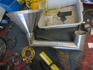 Stainless steel funnel welded to pipe with a flange