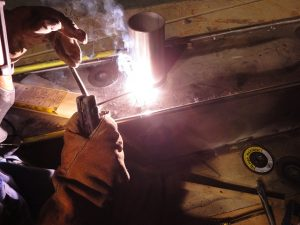 Pipe to plate horizontal fillet weld 1F on stainless steel using E308 smaw electrode.
