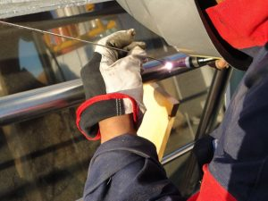 TIG welding stainless steel handrails.