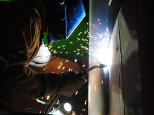 Welding vertical up with FCAW using a E71-T electrode and shielding gas or dual shield.
