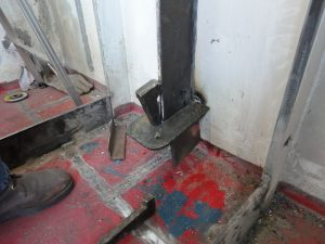 Dogs and wedges used to bend steel during fabrication.